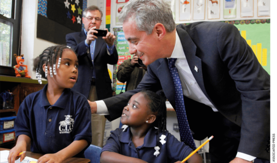 Chicago Mayor Rahm Emanuel meets with students in a school.