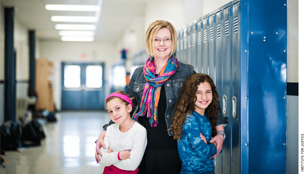 Kendra Espinoza with her two daughters at Stillwater Christian School in Kalispell, Mont.
