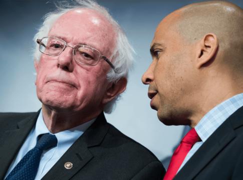 Sens. Bernie Sanders, left, and Cory Booker.