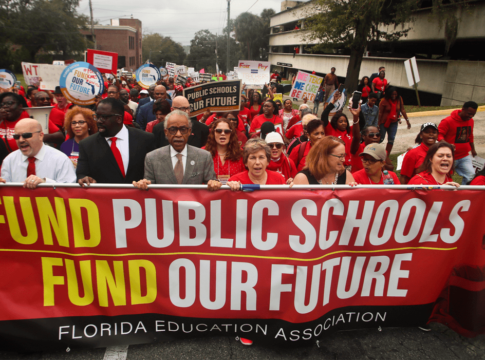 "The Rev. Al Sharpton, front center, leads protestors as they march Monday, Jan. 13, 2020, during the Florida Education Association's ""Take on Tallahassee"" rally at the Old Capitol in Tallahassee, Fla."