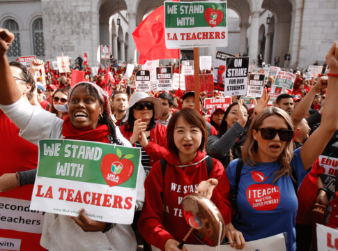 Teachers, parents and students picket outside City Hall in Los Angeles, Friday, Jan. 18, 2019, as part of a strike against Los Angeles Unified School District.
