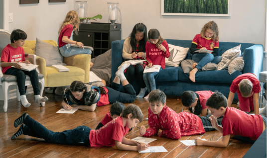 "Students from L.A. Unified's Encino Charter Elementary School —dressed in red to support their teachers—attended a community- organized ""strike school"" in an Encino, Calif., home. Parents took turns hosting children during the teacher strike."