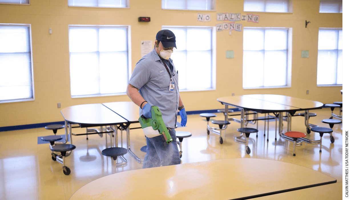 Knox County Schools worker Lonnie Johnson sanitizes the cafeteria with an electrostatic sprayer at Brickey-McCloud Elementary in Knoxville, Tenn., on Friday, March 13, 2020.