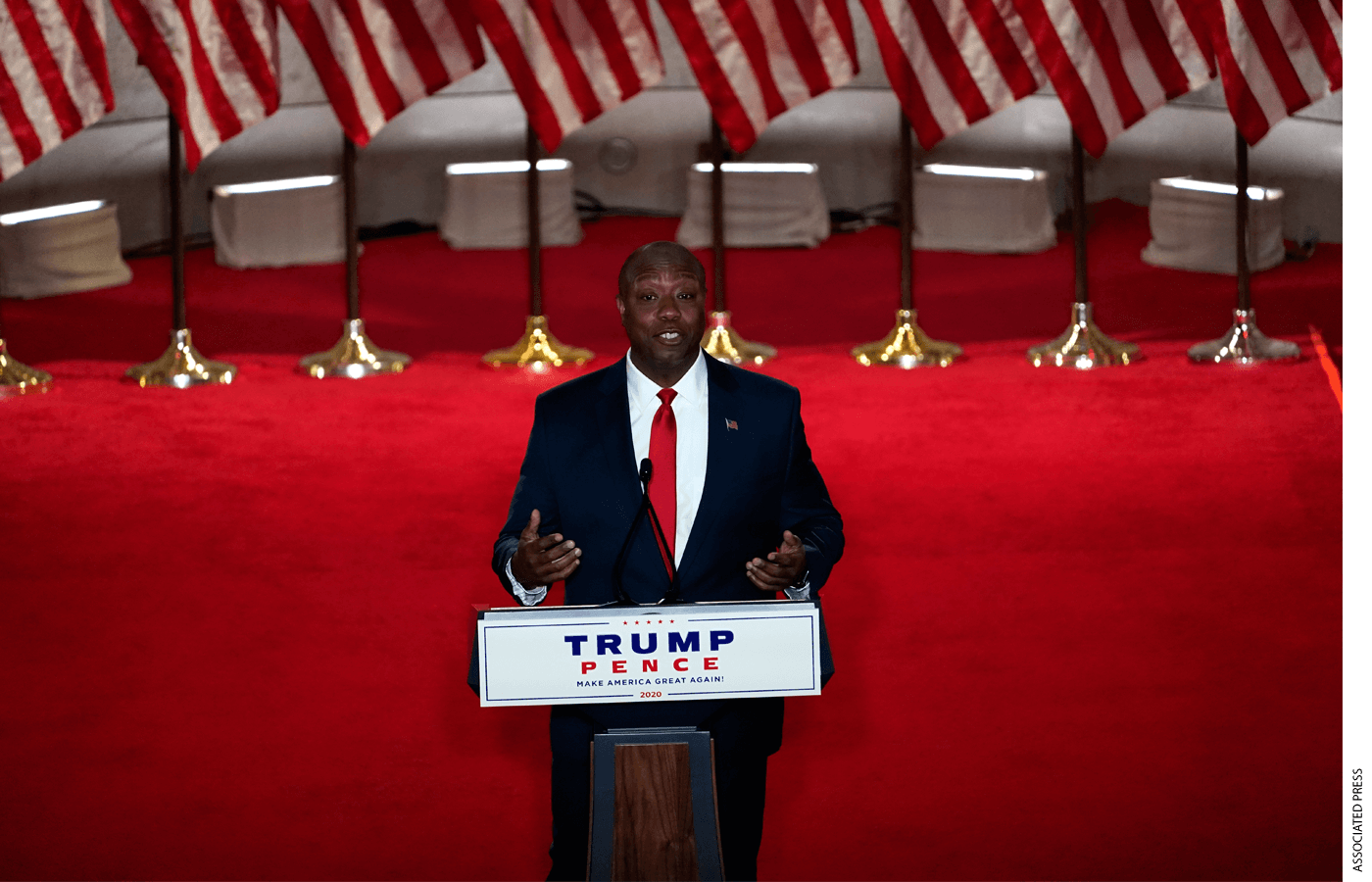 Senator Tim Scott speaking at a podium
