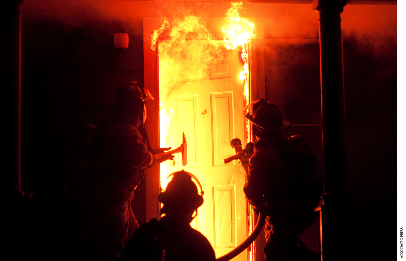 In a Monday, Sept. 17, 2012 photo, Saginaw fire fighters enter a house on the corner of Jackson and Fayette in Saginaw about 11:30 pm.