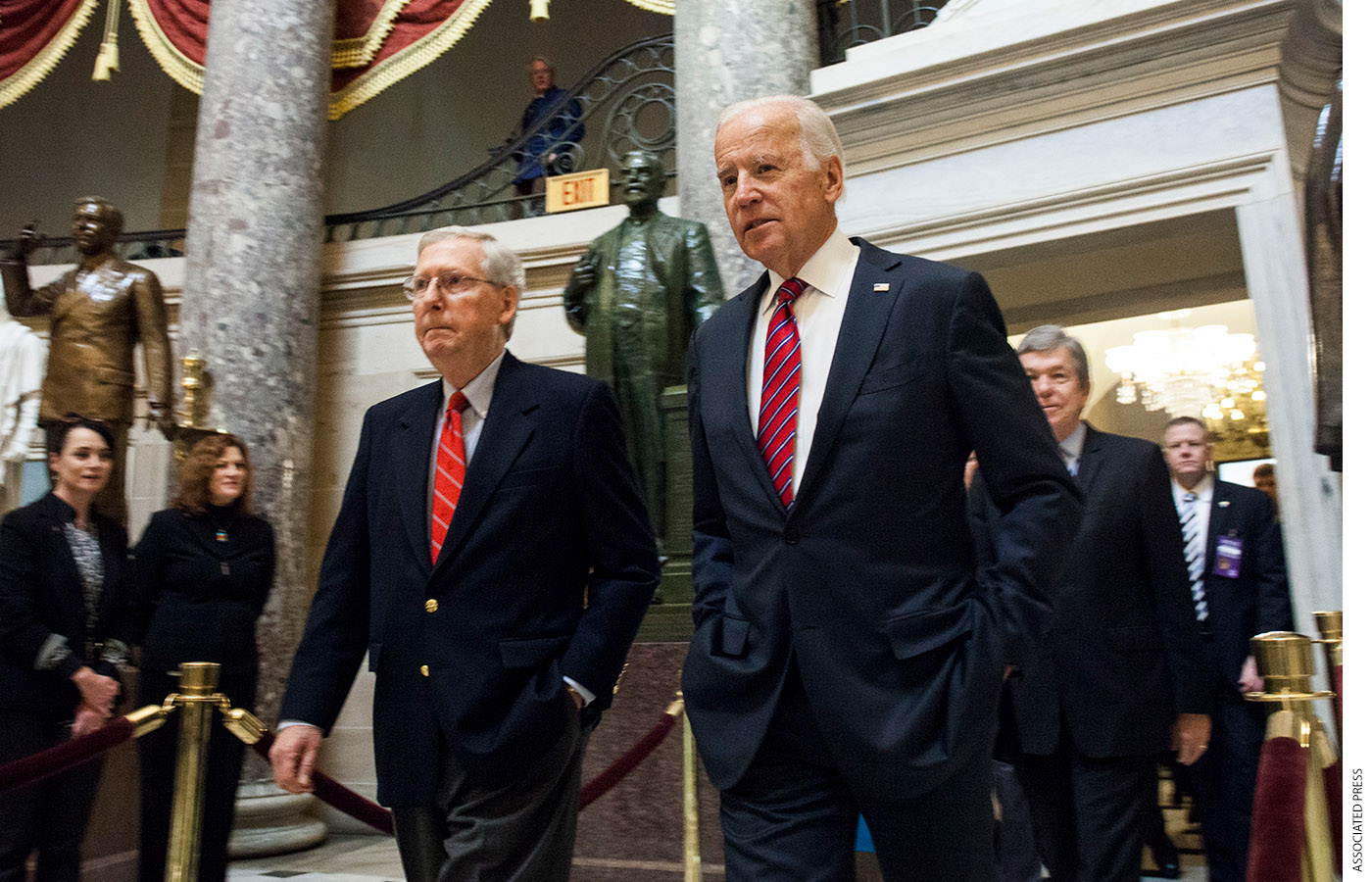Mitch McConnell and Joe Biden head to a joint congressional session to tally the 2016 electoral college votes on January 6, 2017.