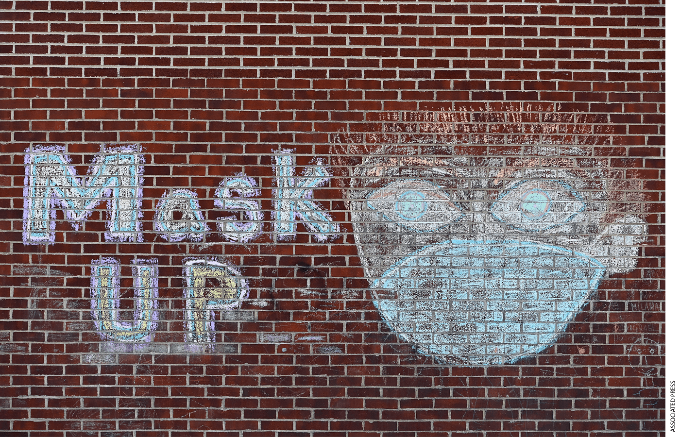 "A ""Mask Up"" chalk drawing decorates PS 139 in Rego Park, Queens, New York City."
