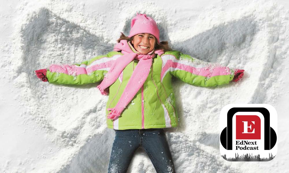 Child making snow angel