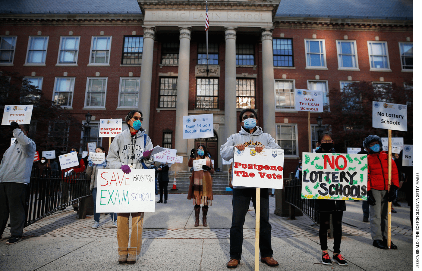 Protesters calling for Boston schools to keep the admissions exam in place for exam schools rally outside of Boston Latin School in Boston on October 18, 2020.