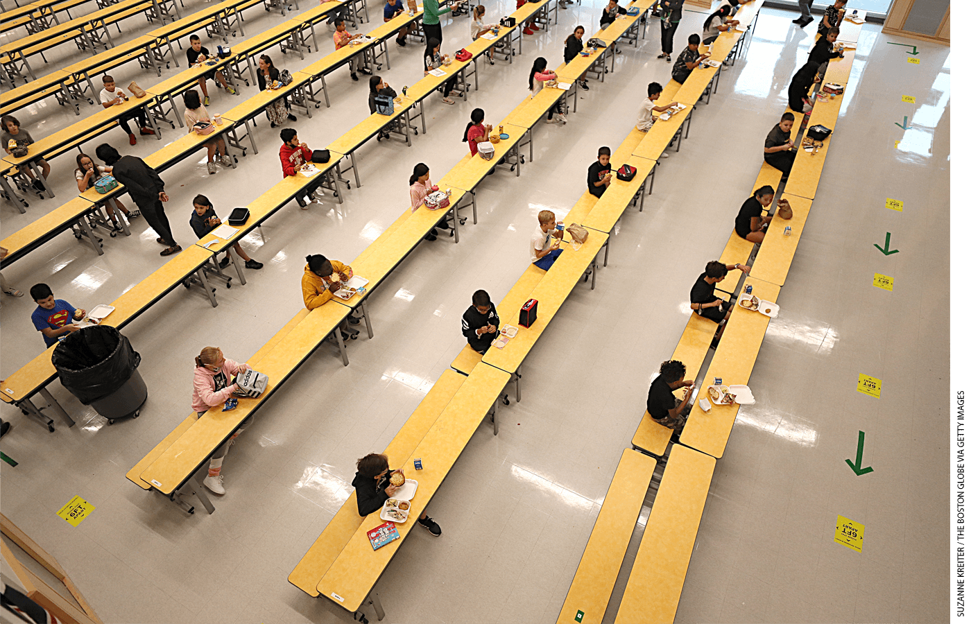 School children are spaced apart in one of the rooms used for lunch at Woodland Elementary School in Milford, Massachusetts.