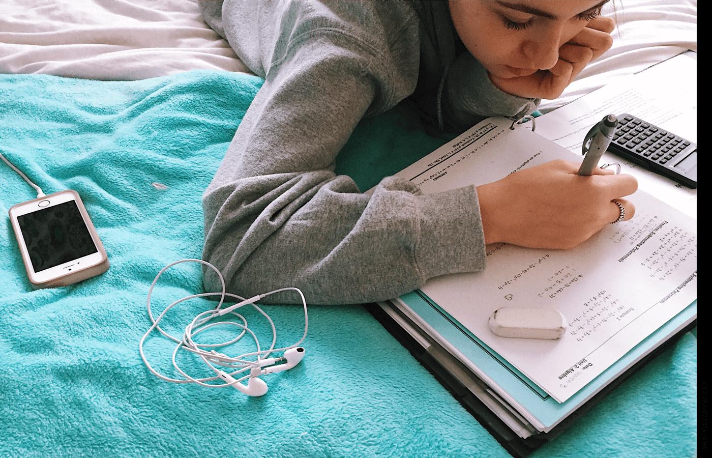 A student working on math homework.
