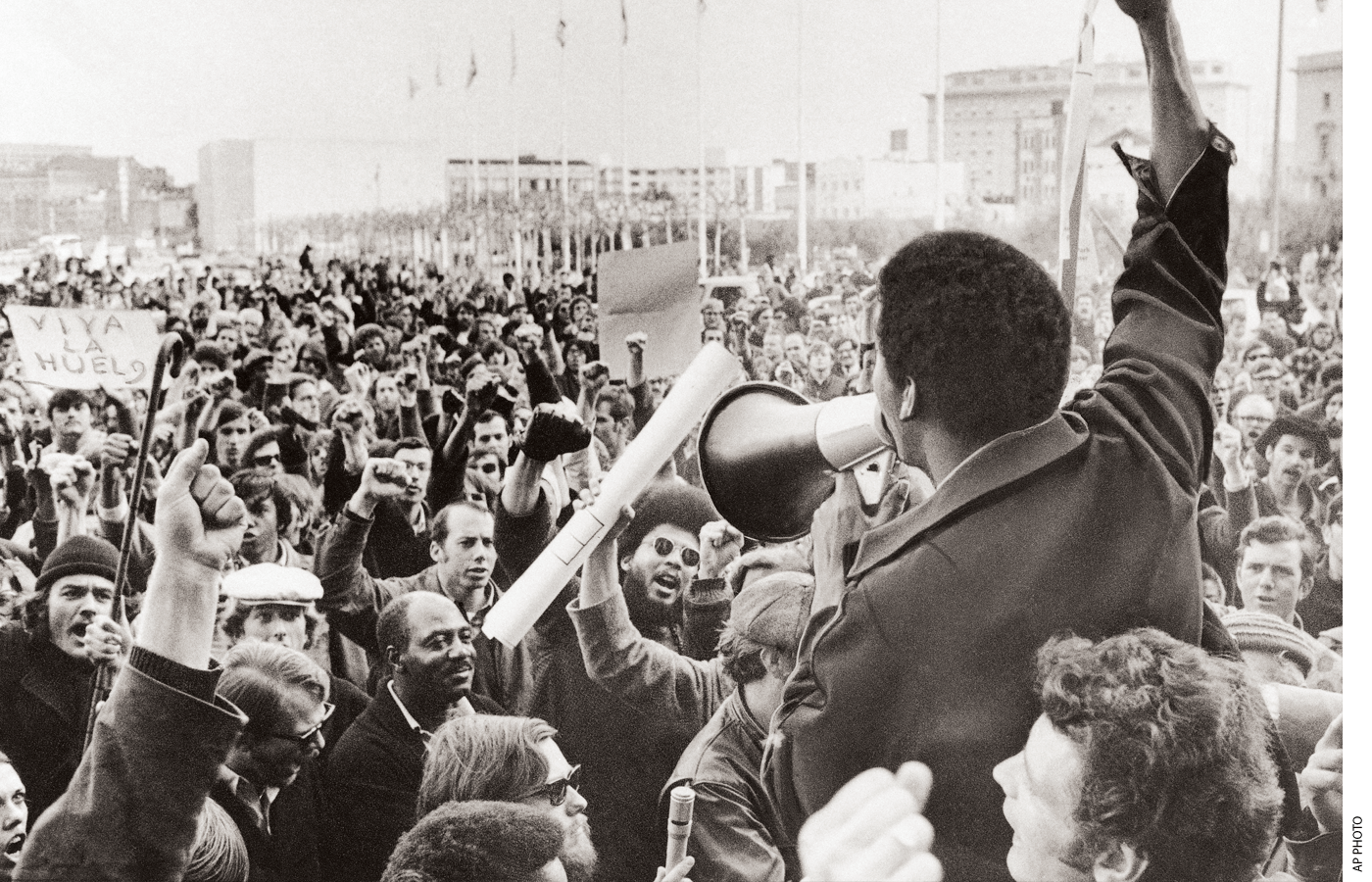A Black Students Union leader in front of a crowd of demonstrators at College in December 1968.