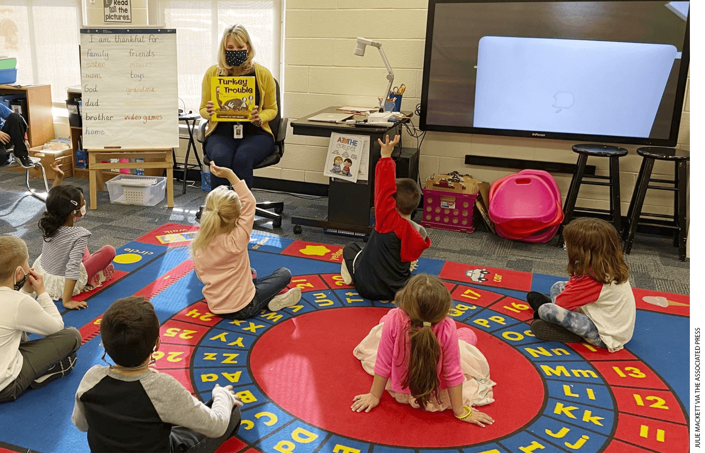Kindergarten teacher Julie Mackett conducts her class at Ft. Meigs Elementary School, in Perrysburg, Ohio.