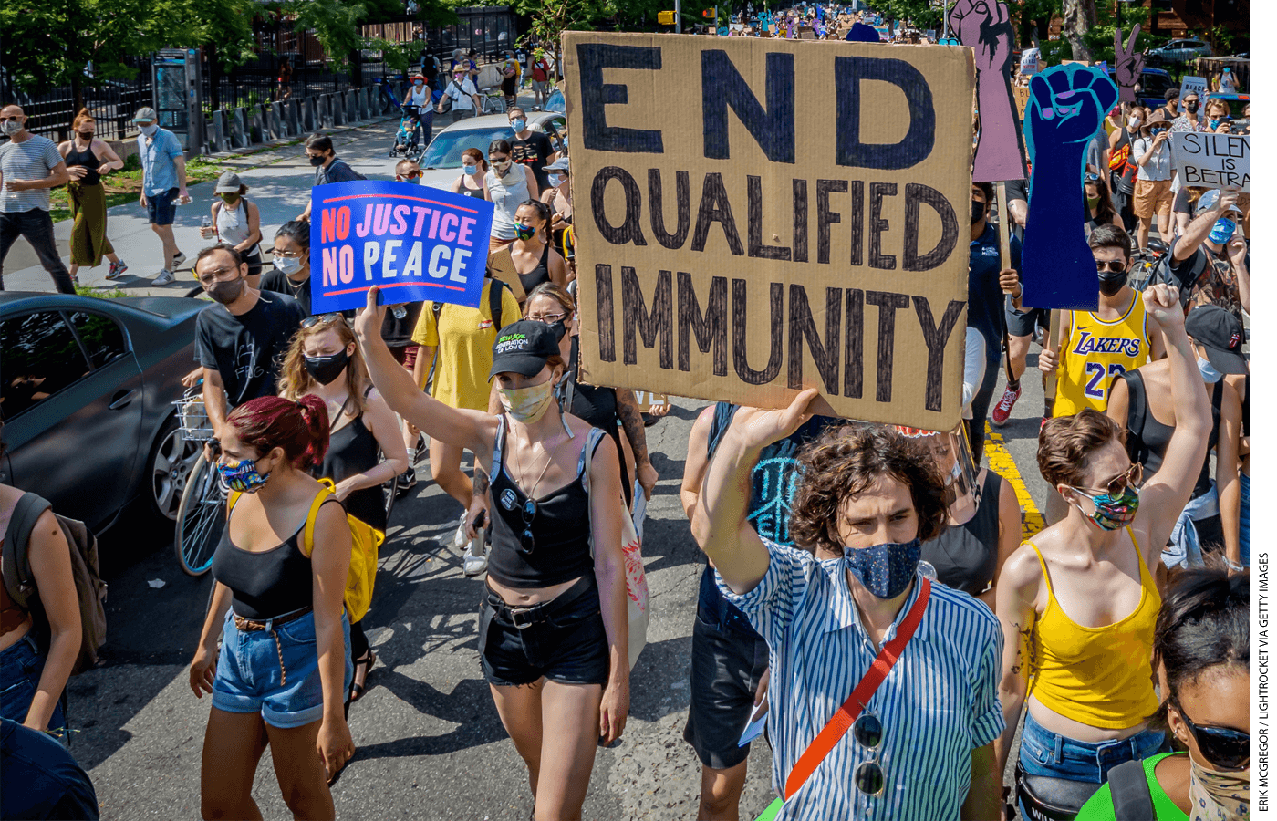 "A protester holds an ""END QUALIFIED IMMUNITY"" sign during a Black Lives Matter protest in Brooklyn, New York, on July 4, 2020."