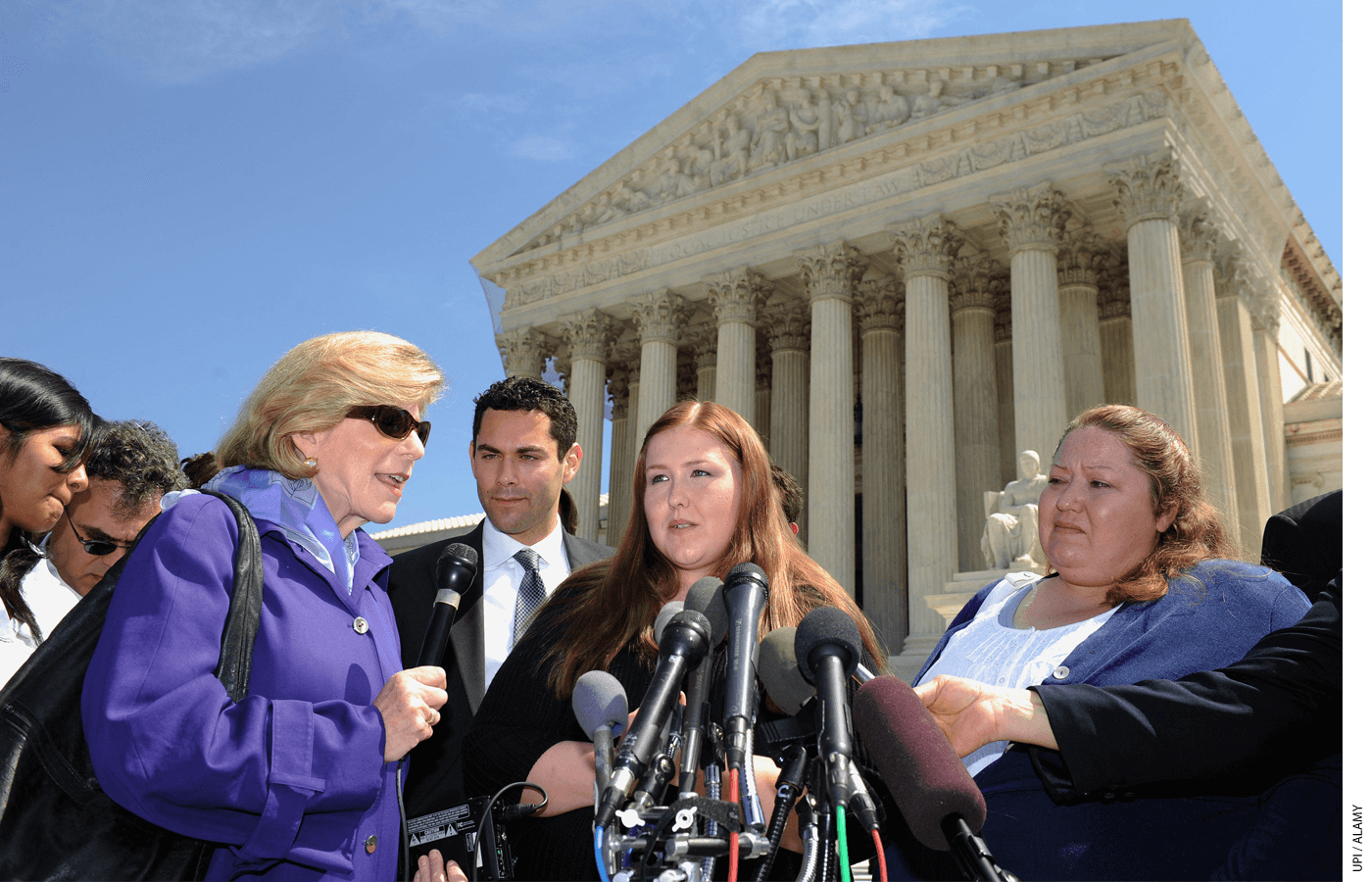 Savana Redding, age 19, speaks to the media in front of the Supreme Court. The court ruled school officials had violated her rights with a search but were protected by qualified immunity.
