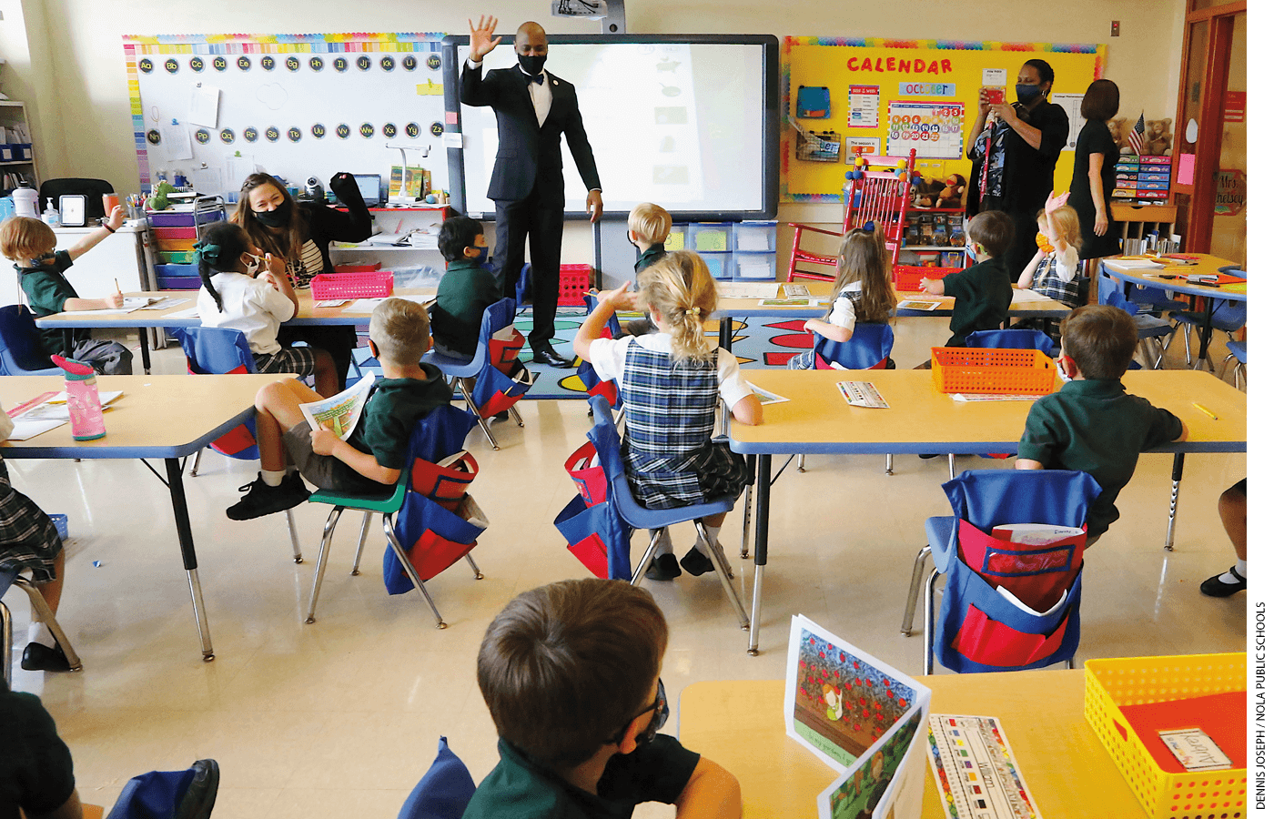 Superintendent Henderson Lewis Jr. stands in front of a class at Edward Hynes Charter School after the school resumed in-person learning in October 2020.