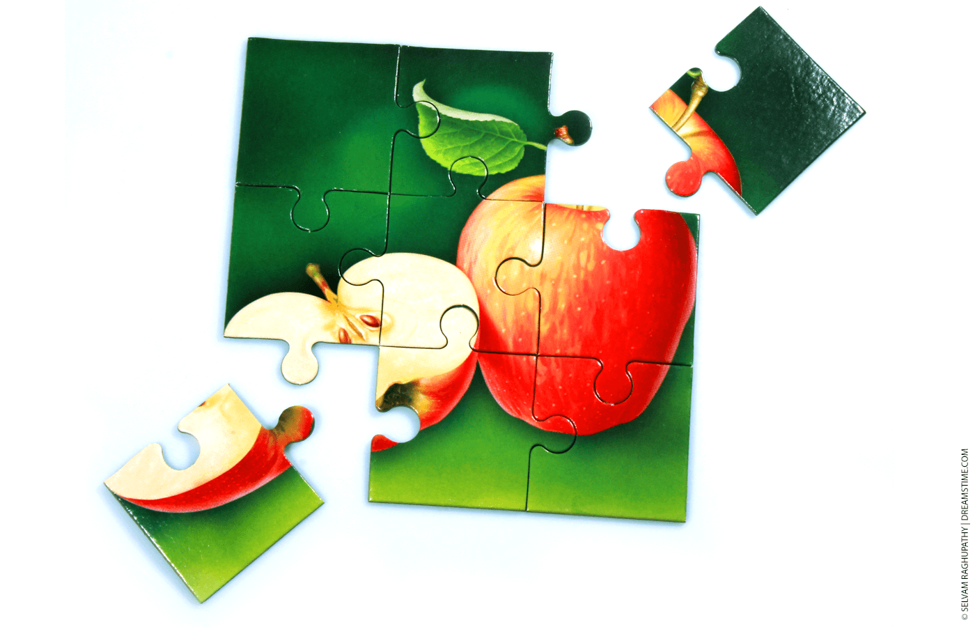 A puzzle with two pieces breaking away
