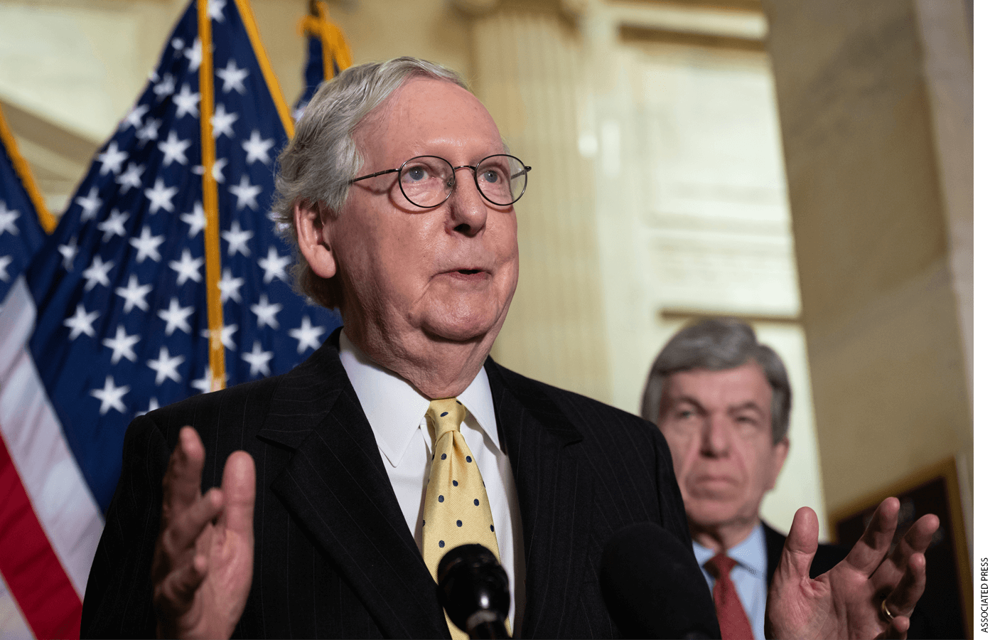 Photo of Sen. Mitch McConnell speaking from behind a podium