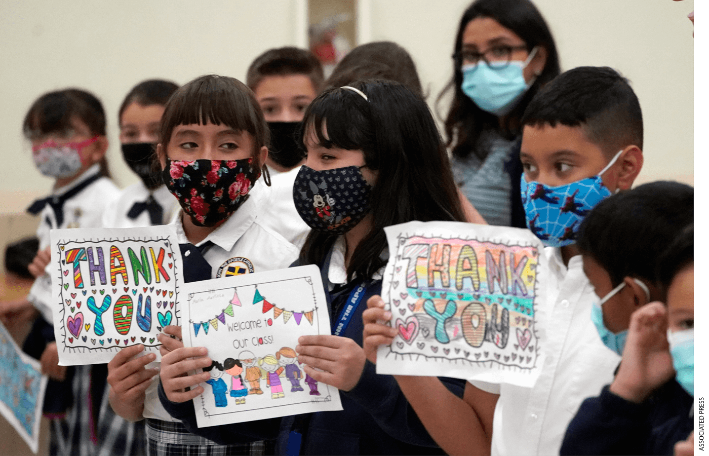 Children wait for Florida Governor Ron DeSantis to arrive at a bill signing ceremony at St. John the Apostle School, Tuesday, May 11, 2021, in Hialeah, Fla.
