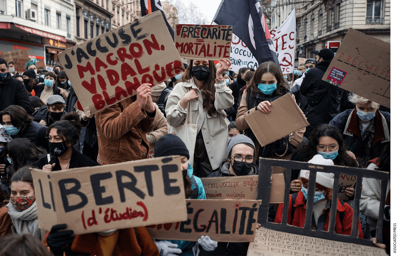 Students hold banners during a demonstration to demand support for workers, in Lyon, central France, Tuesday, Jan. 26, 2021.