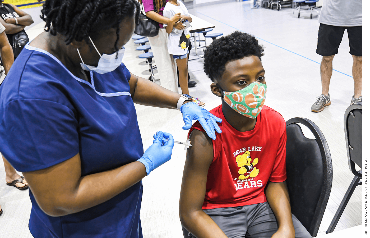 A 12-year-old boy gets vaccinated in Florida.