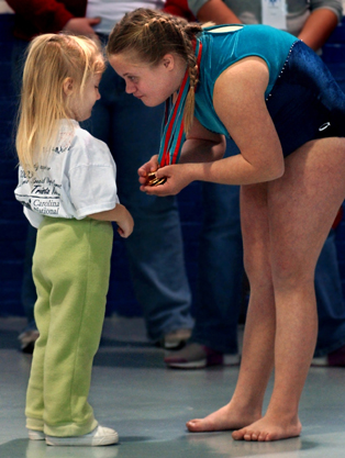 Trista Kutcher shows her little sister, Samantha, her Special Olympics gold medals.