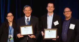 Paul E. Peterson and Matthew Chingos accept their award.