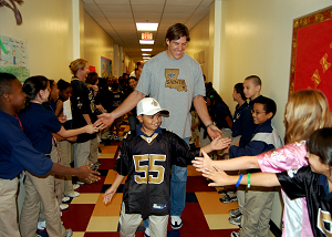 Scott Fujita, a member of the New Orleans Saints, greets more than 200 students of Belle Chasse Academy during a tour of the school as a part of the National Football League's Campaign 60 program. The NFL's Campaign 60 program is intended to encourage youth to exercise for 60 minutes a day. Belle Chasse Academy is the only NASA charter school on a military installation. U.S. Navy photo by Mass Communication Specialist 1st Class Shawn D. Graham (RELEASED)