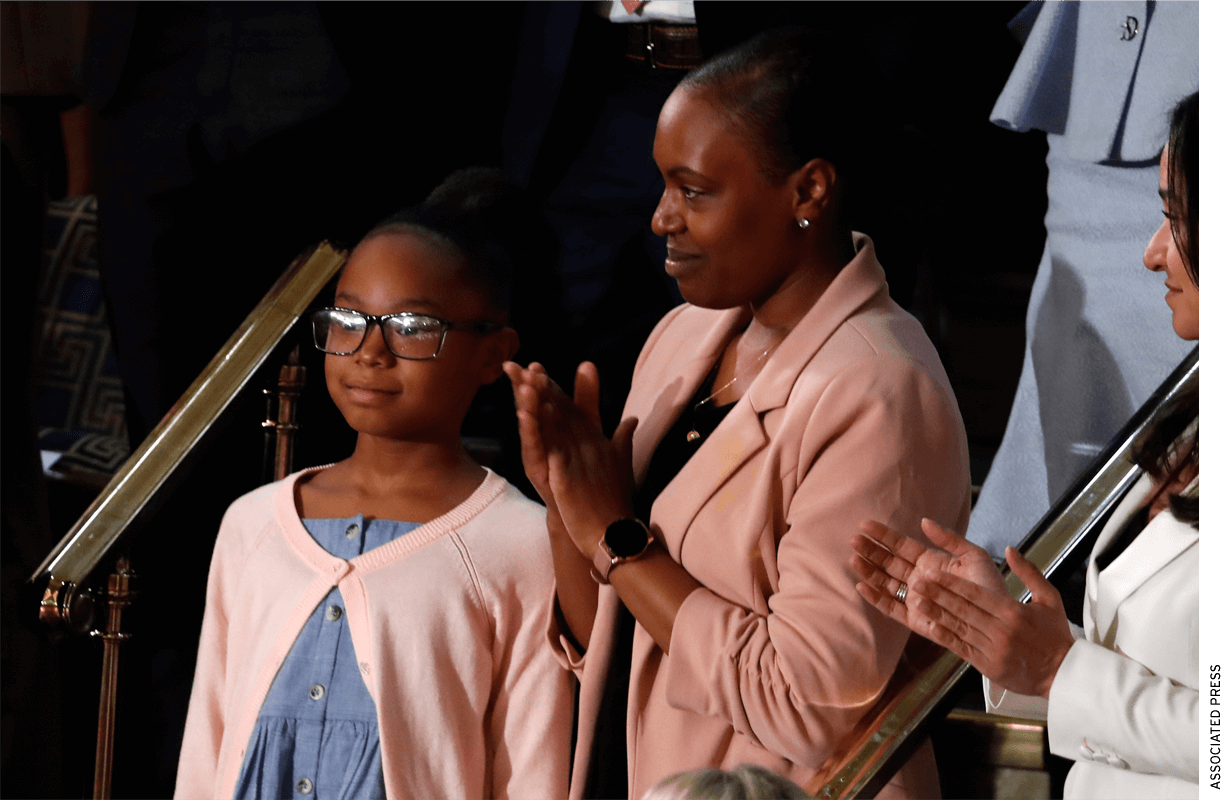 Janiyah, left, and Stephanie Davis of Philadelphia, listen as President Donald Trump delivers his State of the Union address to a joint session of Congress on Capitol Hill in Washington, Tuesday, Feb. 4, 2020
