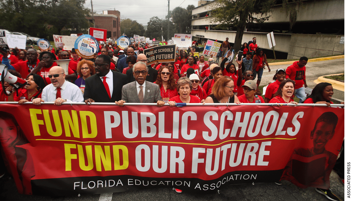 """The Rev. Al Sharpton, front center, leads protestors as they march Monday, Jan. 13, 2020, during the Florida Education Association's """"Take on Tallahassee"""" rally at the Old Capitol in Tallahassee, Fla."""
