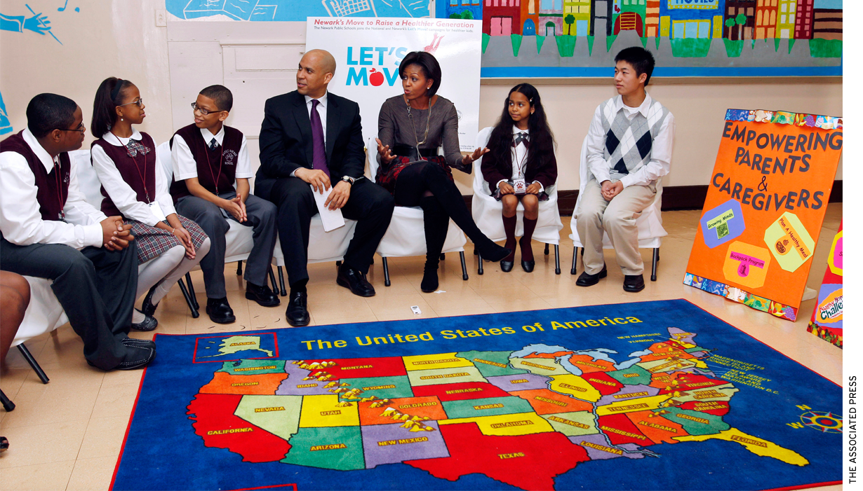 First Lady Michelle Obama and Newark Mayor Cory Booker sit with children at the Maple Avenue School in Newark, N.J., Thursday, Nov. 18, 2010.