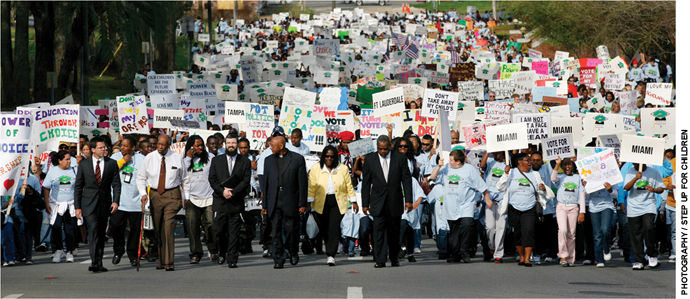 Article opening image: Participants in a rally organized by Step Up for Students march to the state capitol in Tallahassee, Florida, demanding an expansion of the tax credit scholarship program for students from low-income families.