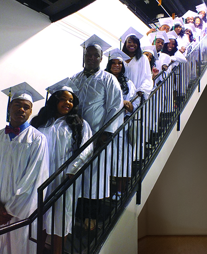 Students from the NET Charter High School on graduation day in February 2014. (Photo/Shane Colman, Courtesy Net Charter High School)