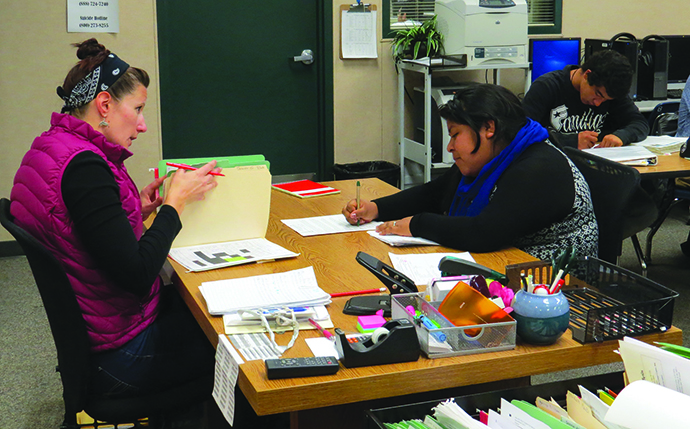 Instructor Amanda Bruckner works with a student at one of Oceanside High School's Academic Acceleration Recovery Centers. (Photo/Courtesy of Oceanside Unified School District Communications Office, Steve Lombard)
