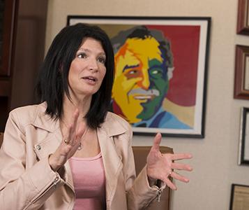 Lily Eskelsen García in her office at NEA headquarters, with a portrait of Gabriel García Márquez by her husband Alberto García in the background.