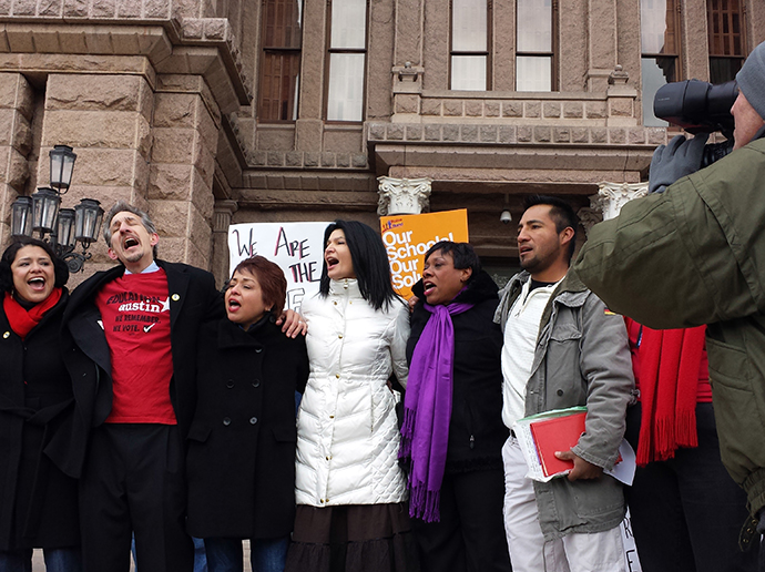 """Lily Eskelsen García and others sing the union anthem """"Solidarity Forever"""" in front of the Texas State Capitol in Austin, December 2013"""
