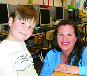 Katie Demick and her son Xander at Riverside's Bryant school.