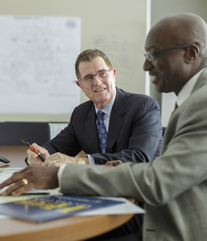 Terry Grier meets with the district's chief financial officer, Kenneth Huewitt.