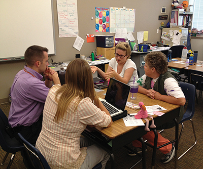 In Denver, teachers from the charter school Highline Academy and the district school Cole Academy of Arts and Science collaborate on curriculum plans and interim assessments