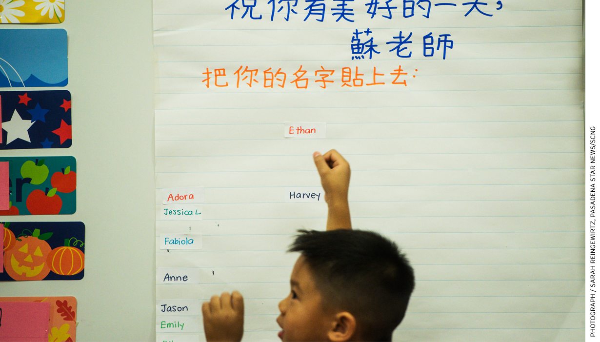 """In Rowland Heights, Calif., Ethan Heng, 5, adds his name to a board that reads in Mandarin, """"We can recognize our English names."""""""