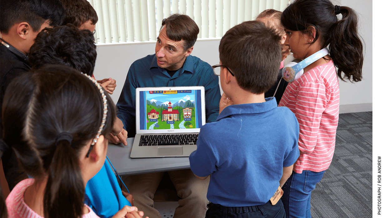 Art of Problem Solving founder Richard Rusczyk displays the Beast Academy online learning system to pupils at Art of Problem Solving Academy San Diego.