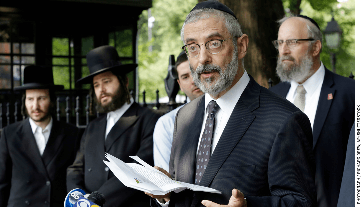 Rabbi Chaim Dovid Zwiebel, foreground, credits his Talmud study at a Jewish school in New York City as a help in eventually preparing him for law school.