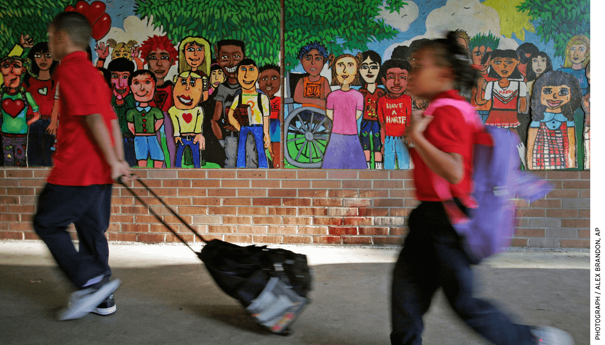 Children carry their books into Alice Harte Elementary charter school in New Orleans. The state's scholarship program took place in the context of other recent reforms.