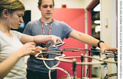At NuVu, two students work on a transformative chair.