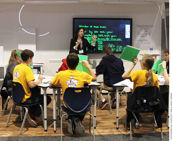 Eureka Math Director Jill Diniz teaches a demonstration lesson on exponential decay to grade 9 students from Lafayette Parish School System.