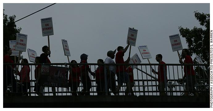 Striking teachers from the Seattle School District walk a picket line on September 10, 2015
