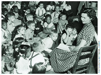 """Of the characteristics that were measured in the Coleman Report, """"those that bear the highest relationship to pupil achievement are first, the teacher's score on the verbal skills test, and then his educational background."""" An integrated kindergarten class in the 1950s in Washington, D.C."""