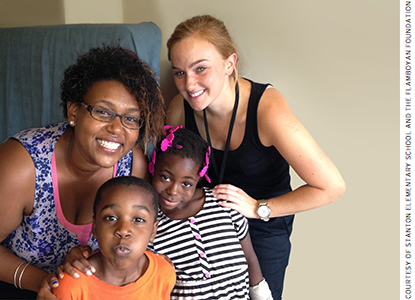 Home visits change the dynamic. Abigail VanDam (right) and Makede Yiman (left) from Stanton Elementary School visit with the Walters family.