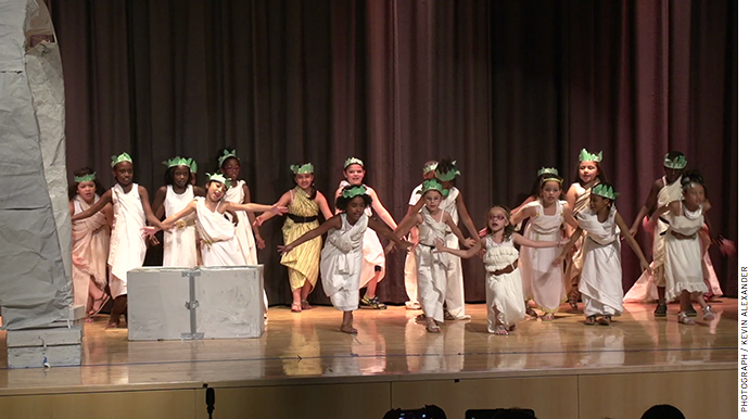 """Second graders at Icahn Charter School 2 perform a play titled """"The Odyssey"""" at the school's end-of-year Core Knowledge"""