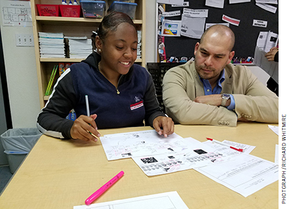 Emilio Pack, founder of the STEM Prep charter schools, with a student